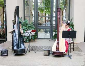 Harpists performing inside the Conservatory.