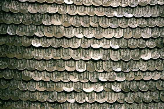 """Do-ho Suh, """"Some/One."""" Coat of armor is made entirely of personalized dog tags."""
