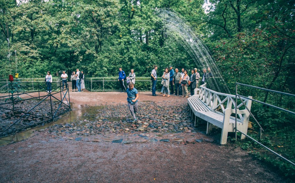 "One of the ""trick"" fountains at Peterhof Palace- and a kiddo trying to outrun it!"