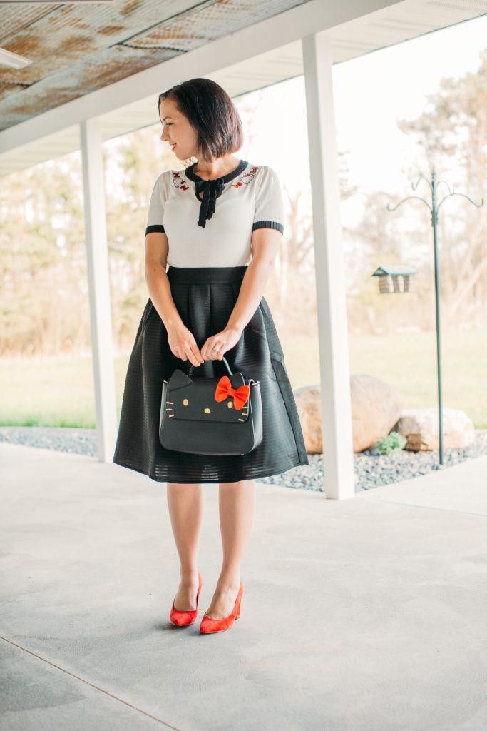 a black midi skirt by Pocket Passionista and Hello Kitty bag