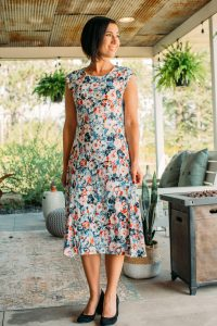 Lindsey of Have Clothes, Will Travel wears a floral Ralph Lauren midi dress ordered from Zappos Clothing and black suede pumps