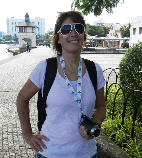 Wendy with video camera in Kuching, Borneo. This was several cameras ago . Video is Wendy's other hobby (besides travelling).