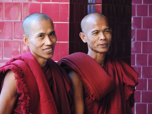 Myanmar Buddhist monks wear maroon robes instead of the more familiar saffron ones.