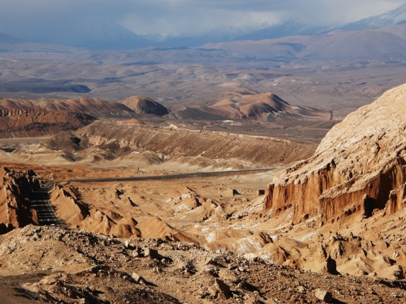 A road winds through the desert landscape near the Valley of the Moon in Chile.