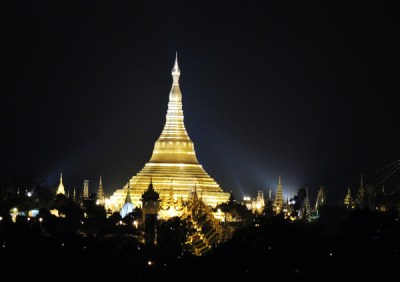 Shwedagon Pagoda lights up the night sky. It is the most sacred Buddhist pagoda in Myanmar
