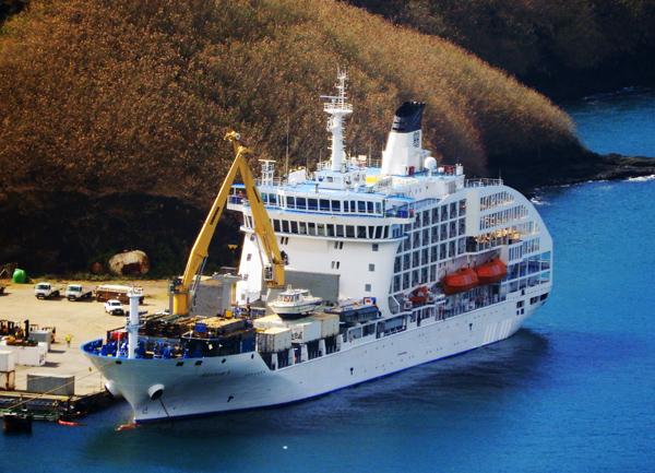 The Aranui 5 passenger/cargo ship unloading at the dock in Nuku Hiva, Marquesas Islands.