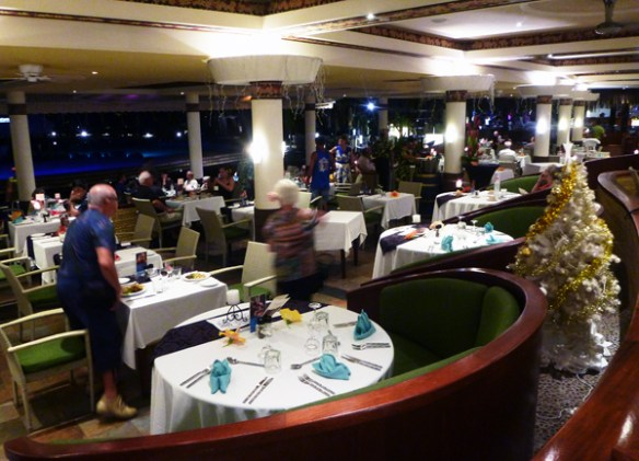 A view from the raised level of Te Tiare restaurant looking over the lower seating level towards the swimming pool.