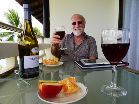 Enjoying a glass of wine and some fresh fruit on our balcony. We bought the wine duty-free before our flight from Raarotonga as alcohol is expensive in French Polynesia.