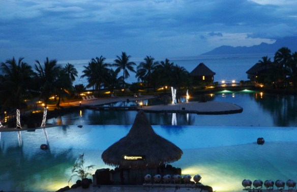 The view from the Lobby Bar as night falls at the Tahiti Intercontinental Hotel and the lights around the pools go on.