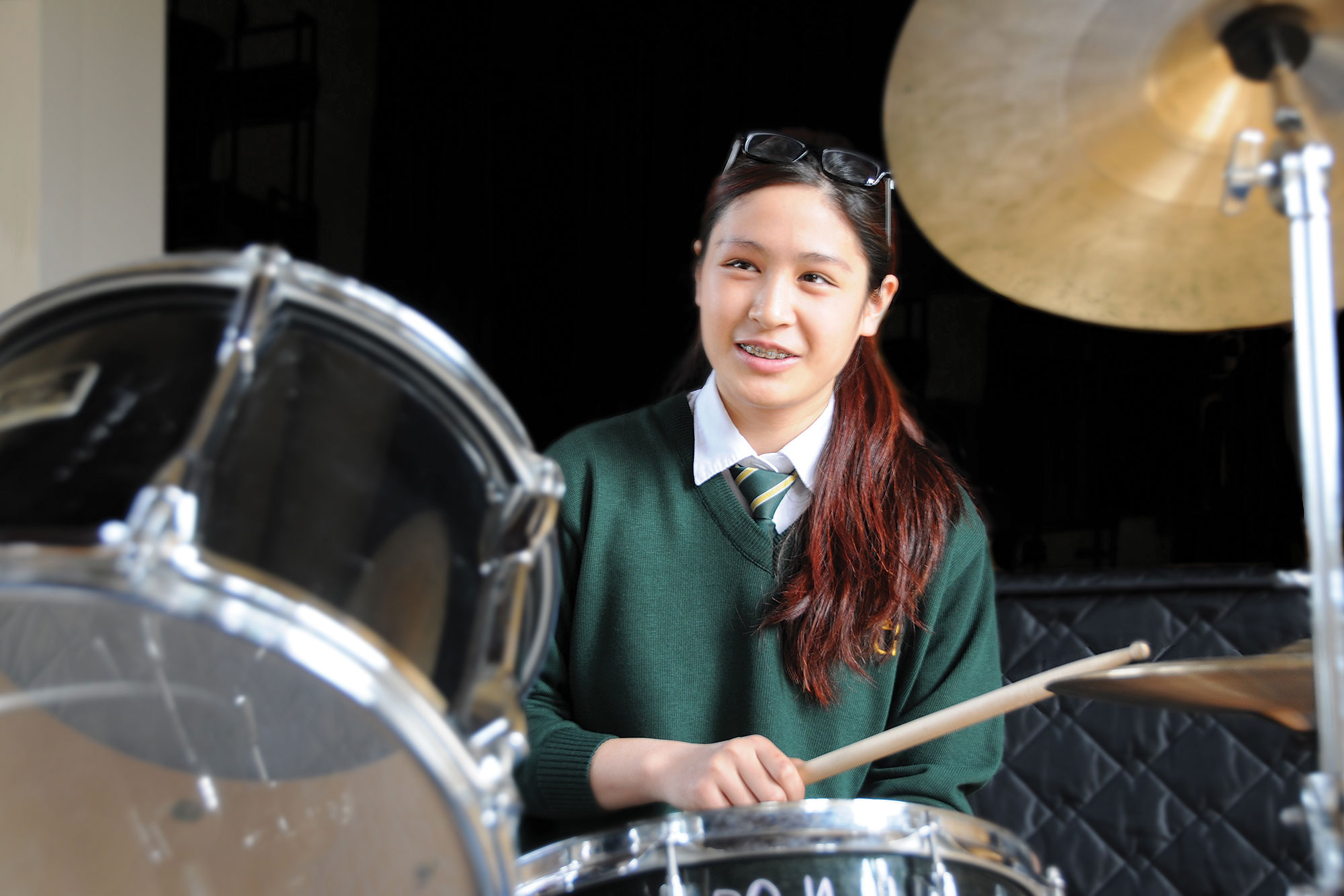 A student playing drums.