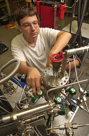 Ralf Kaiser working with scientific equipment