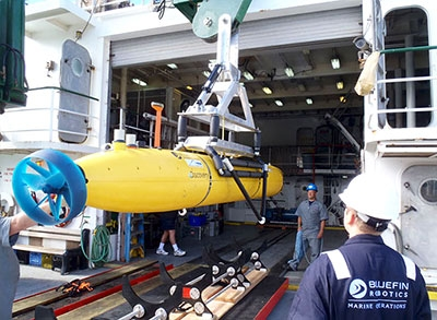 Autonomous underwater vehicle being unloaded