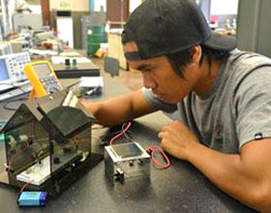 student working on battery