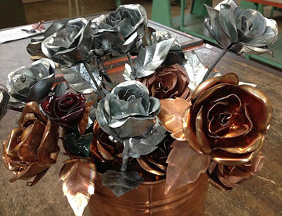 Sheet metal and copper roses on sale.