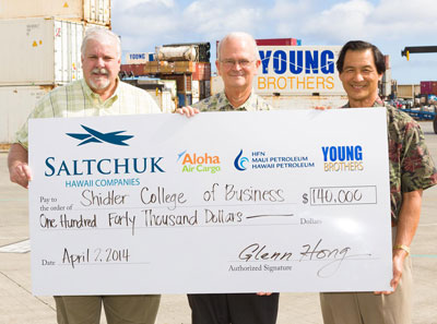 3 men holding check