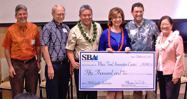 people holding big check