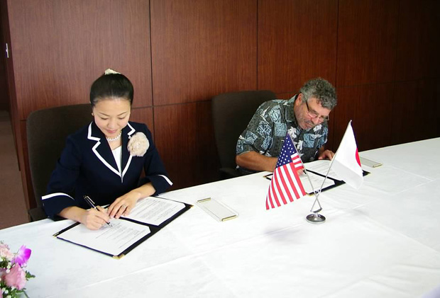 two people signing agreement