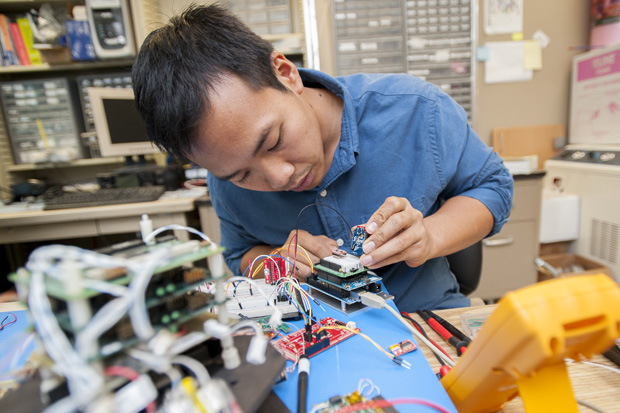 student working on computer component