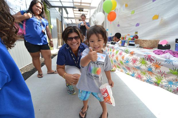 child at the Hawaii C C Palamanui celebration