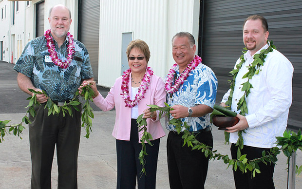 four people untying maile lei