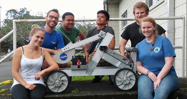 student with robotic vehicle
