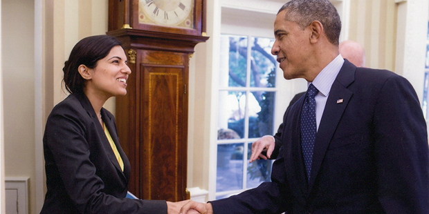 alumna shaking hands with President Obama