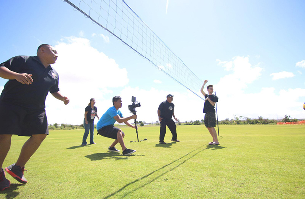 UH West Oahu creative media students filming volleyball on the lawn