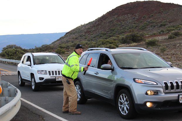 Maunakea staff member talking to people in a car