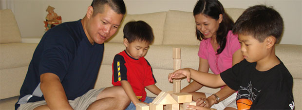 Family playing with blocks in a living room