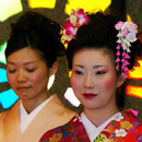 two women dress in traditional Japanese attire
