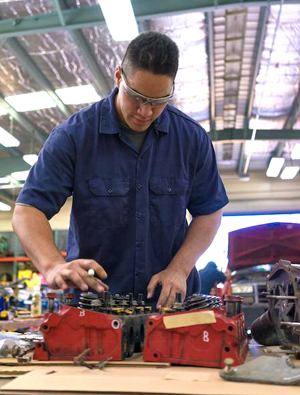 diesel technology student working on engine part