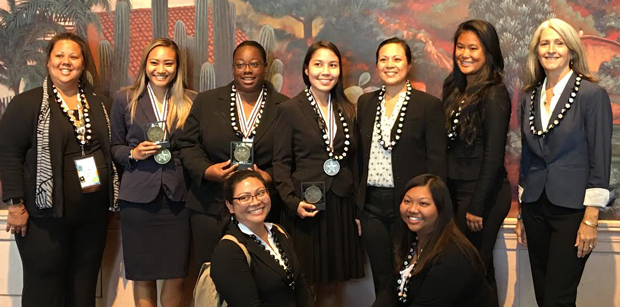 group of smiling women in professional attire