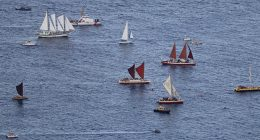 Hokulea and other boats and ships in the water