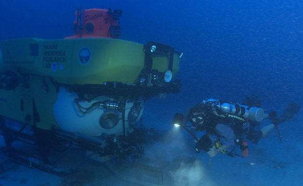Rebreather diver and Pisces V sub collecting coral and macroalgae