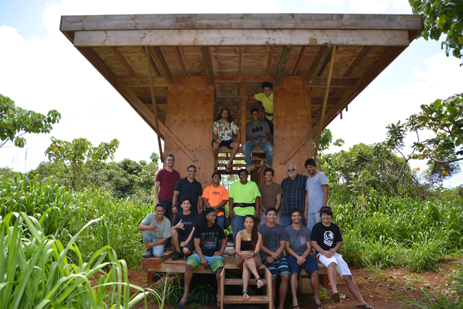 group of students and instructors at the tiny house