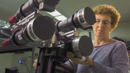 Habbal examining telescope and cameras