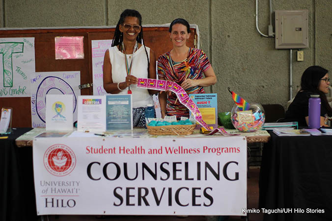 Smiling women standing at a counseling center table