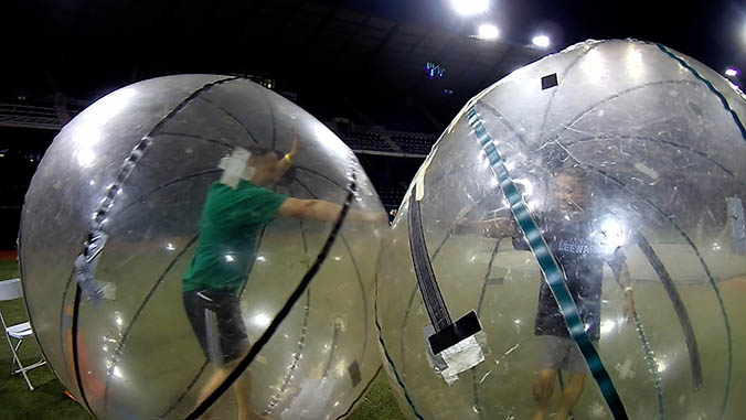 Two people in giant inflatable balls