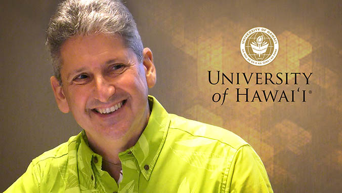 David Lassner and the University of Hawaii seal