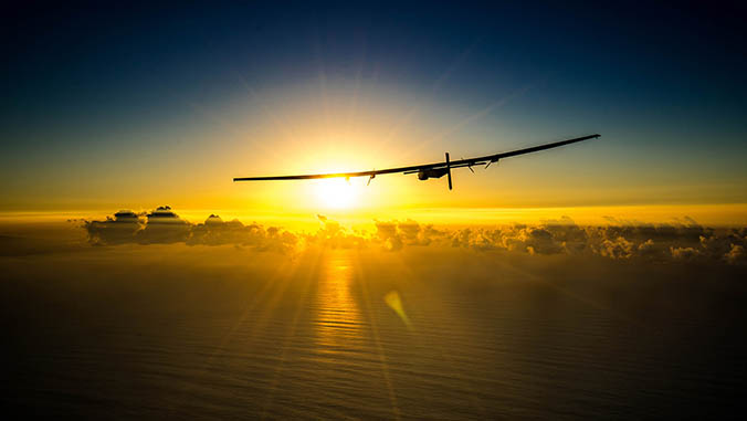The Solar Impulse 2 flying over the ocean toward the sun