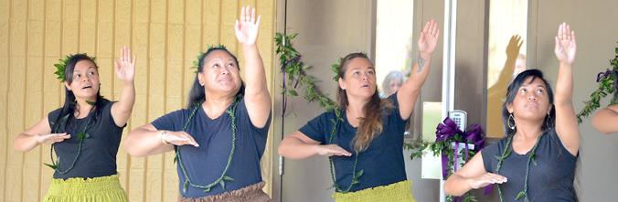 4 people performing hula