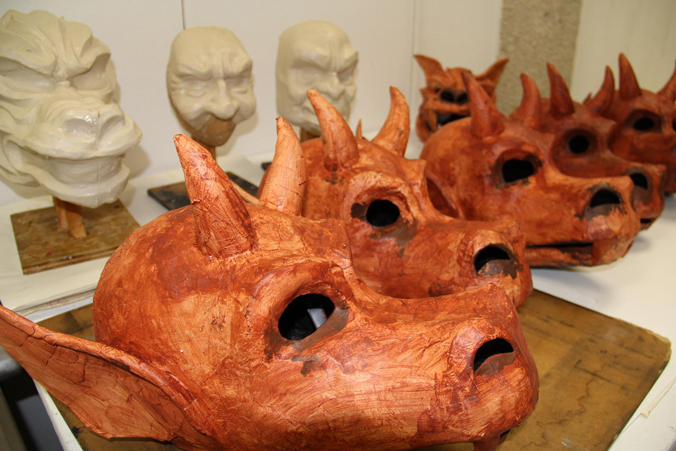 A row of demon masks
