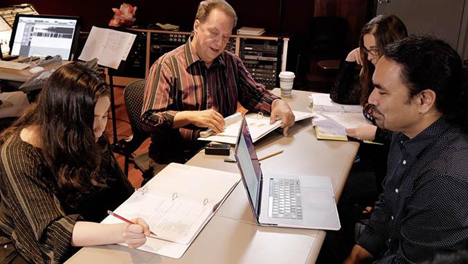 Aulii Cravalho, Puakea Nogelmeier, Tammy Hailiopua Baker and Aaron Sala working with the Moana script
