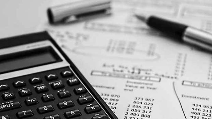 Calculator and paper with mathematical figures