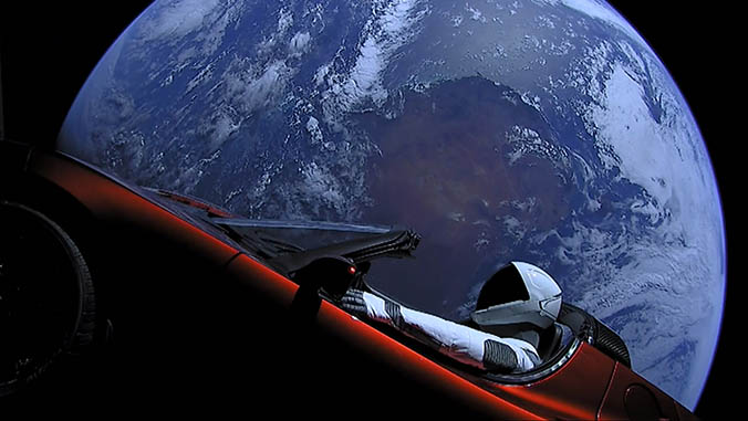 Starman mannequin in the Tesla Roadster with Earth in the background