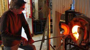 Rick Mills heats glass in a furnace