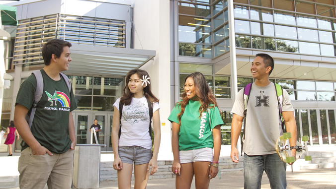 4 students standing in front of U H Manoa Warrior Rec Center