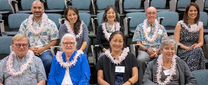 9 people sitting in auditorium