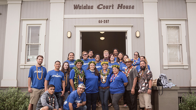 People standing in front of the Waialua Court House