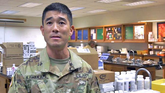 Kawakami in reserve uniform in a lab